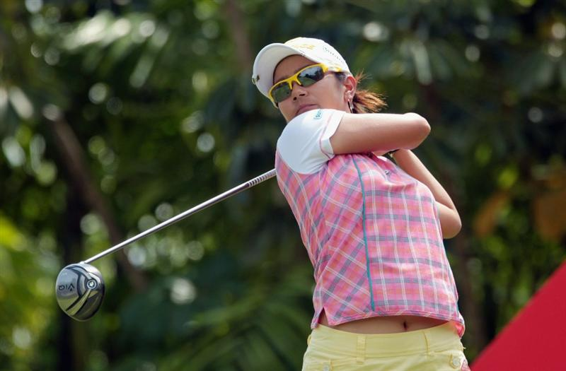 SINGAPORE - FEBRUARY 27:  Ai Miyazato of Japan watches her tee shot on the seventh hole during the final round of the HSBC Women's Champions 2011 at the Tanah Merah Country Club on February 27, 2011 in Singapore, Singapore.  (Photo by Scott Halleran/Getty Images)