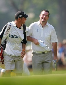 Kenneth Ferrie shares a laugh with Phil Mickelson's caddie  during the final round of the 2006 U.S. Open Championship at Winged Foot Golf Club in Mamaroneck, New York on June 18, 2006.Photo by Sam Greenwood/WireImage.com