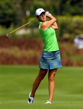 KUALA LUMPUR, MALAYSIA -OCTOBER 21: Michelle Wie of USA plays her fairway shot on the 5th hole during the Sime Darby Pro-Am at the KLGCC Golf Course on October 21, 2010 in Kuala Lumpur, Malaysia.  (Photo by Stanley Chou/Getty Images)