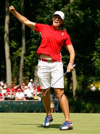 SUGAR GROVE, IL - AUGUST 23:  Juli Inkster of the U.S. Team celebrates her birdie putt on the 16th green during the Sunday singles matches at the 2009 Solheim Cup at Rich Harvest Farms on August 23, 2009 in Sugar Grove, Illinois.  (Photo by Chris Graythen/Getty Images)