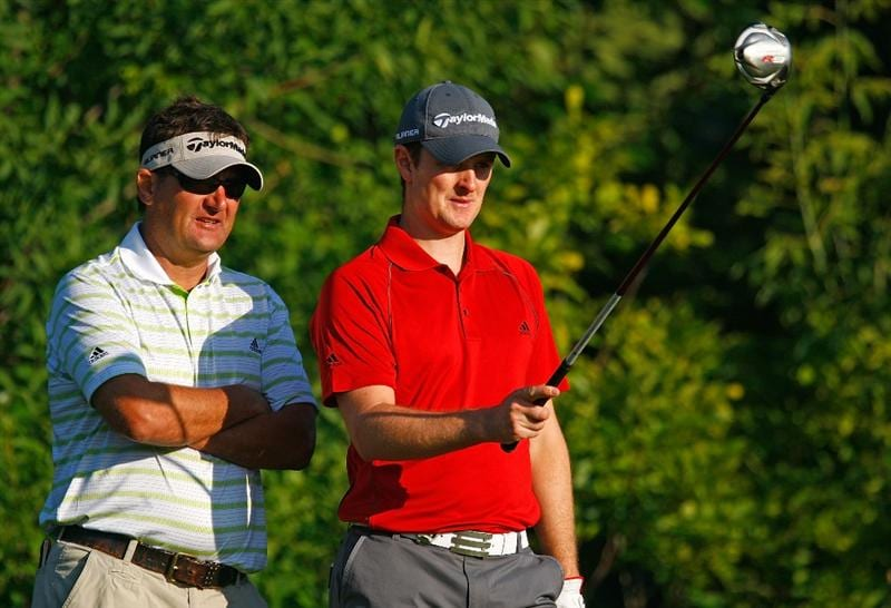 CHASKA, MN - AUGUST 12:  Justin Rose of England (R) chats with his caddie Mark Fulcher during the third preview day of the 91st PGA Championship at Hazeltine National Golf Club on August 12, 2009 in Chaska, Minnesota.  (Photo by Scott Halleran/Getty Images)