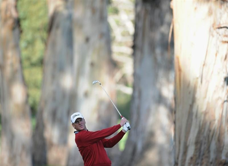 PACIFIC PALISADES, CA - FEBRUARY 17:  Robert Karlsson of Sweden plays his second shot from the trees on the 12th hole during the first round of the Northern Trust Open at the Riviera Country Club on February 17, 2011 in Pacific Palisades, California.  (Photo by Harry How/Getty Images)