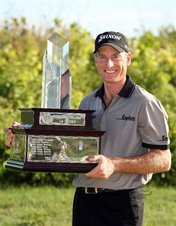TUCKER'S TOWN, BERMUDA - OCTOBER 15: Jim Furyk of the USA poses with the winners trophy after winning the PGA Grand Slam of Golf at the Mid Ocean Club on October 15, 2008 in Tucker's Town, Bermuda. (Photo by Ross Kinnaird/Getty Images)