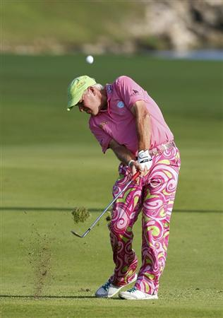PLAYA DEL CARMEN, MEXICO - FEBRUARY 25:  John Daly hits a shot from the fairway during the second round of the Mayakoba Golf Classic at Riviera Maya-Cancun held at El Camaleon Golf Club on February 25, 2011 in Playa del Carmen, Mexico.  (Photo by Michael Cohen/Getty Images)