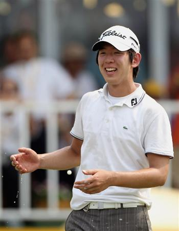 KUALA LUMPUR, MALAYSIA - MARCH 07:  Noh Seung-yul of Korea celebrates on the 18th green after winning the Maybank Malaysian Open at the Kuala Lumpur Golf and Country Club on March 7, 2010 in Kuala Lumpur, Malaysia.  (Photo by Andrew Redington/Getty Images)