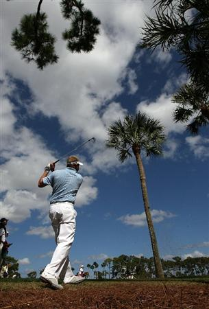 PALM BEACH GARDENS, FL - MARCH 06:  Carl Pettersson hits out of the trees on the eighth hole during the second round of The Honda Classic at PGA National Resort and Spa on March 6, 2009 in Palm Beach Gardens, Florida.  (Photo by Doug Benc/Getty Images)