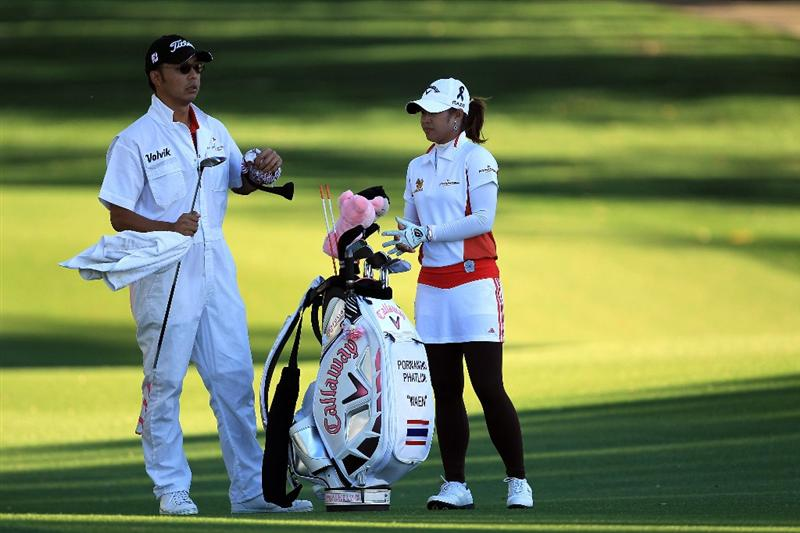 RANCHO MIRAGE, CA - MARCH 31:  Pornanong Phatlum of Thailand plays her second shot at the par 5, 2nd hole during the first round of the 2011 Kraft Nabisco Championship on the Dinah Shore Championship Course at the Mission Hills Country Club on March 31, 2011 in Rancho Mirage, California.  (Photo by David Cannon/Getty Images)