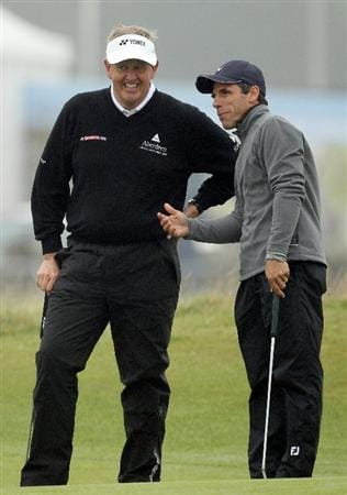 ST ANDREWS, SCOTLAND - OCTOBER 08:  Colin Montgomerie of Scotland talks with Gianfranco Zola on the first green during the second round of The Alfred Dunhill Links Championship at The Old Course on October 8, 2010 in St Andrews, Scotland.  (Photo by Ross Kinnaird/Getty Images)