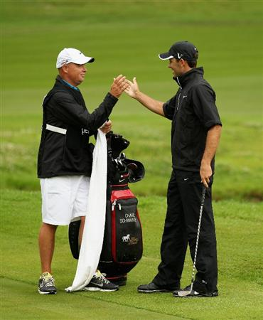 JOHANNESBURG, SOUTH AFRICA - JANUARY 16:  Charl Schwartzel of South Africa celebrates with his caddie after chipping in out of the 13th greenside bunker for birdie during the fourth round of the Joburg Open at Royal Johannesburg and Kensington Golf Club on January 16, 2011 in Johannesburg, South Africa.  (Photo by Warren Little/Getty Images)