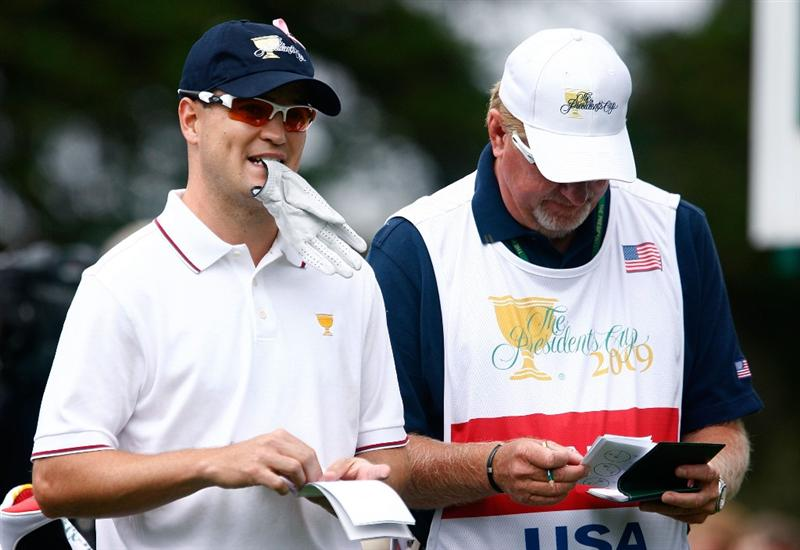 SAN FRANCISCO - OCTOBER 08:  Zach Johnson of the USA Team waits with his caddie Damon Green on the second tee during the Day One Foursome Matches of The Presidents Cup at Harding Park Golf Course on October 8, 2009 in San Francisco, California.  (Photo by Scott Halleran/Getty Images)