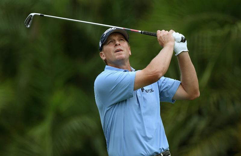 DORAL, FL - MARCH 10:  Steve Stricker watches his tee shot on the 15th hole during the first round of the 2011 WGC- Cadillac Championship at the TPC Blue Monster at the Doral Golf Resort and Spa on March 10, 2011 in Doral, Florida.  (Photo by Sam Greenwood/Getty Images)