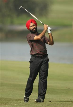 NEW DELHI, INDIA - FEBRUARY 19:  Sujjan Singh of India ihits an iron shot during the third round of the Avantha Masters held at The DLF Golf and Country Club on February 19, 2011 in New Delhi, India.  (Photo by Ian Walton/Getty Images)