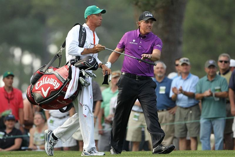 AUGUSTA, GA - APRIL 07:  Phil Mickelson takes a club from his caddie Jim Mackay on the 14th hole during the first round of the 2011 Masters Tournament at Augusta National Golf Club on April 7, 2011 in Augusta, Georgia.  (Photo by Jamie Squire/Getty Images)