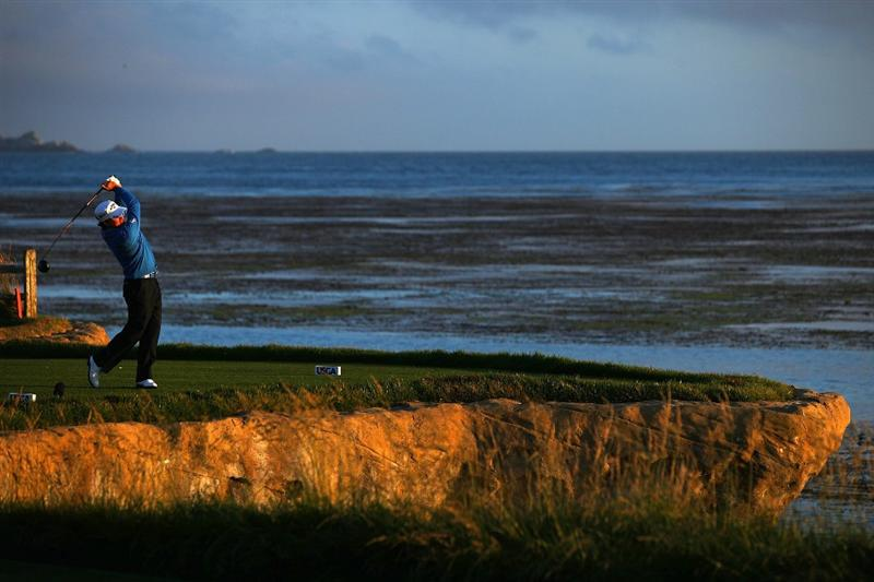 PEBBLE BEACH, CA - JUNE 19:  Graeme McDowell of Northern Ireland watches his tee shot on the 18th hole during the third round of the 110th U.S. Open at Pebble Beach Golf Links on June 19, 2010 in Pebble Beach, California.  (Photo by Donald Miralle/Getty Images)