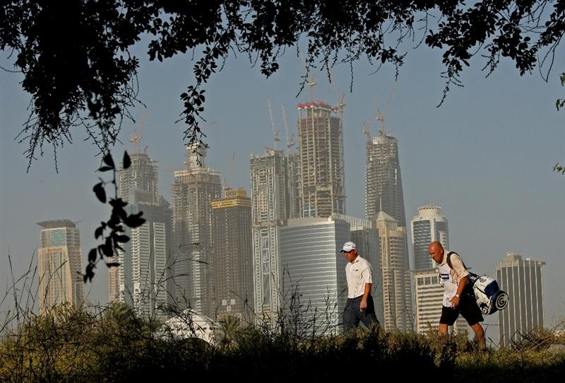 DUBAI, UNITED ARAB EMIRATES - FEBRUARY 04:  David Howell of England walks with his caddie on the third hole during the first round of the Omega Dubai Desert Classic on February 4, 2010 in Dubai, United Arab Emirates.  (Photo by Andrew Redington/Getty Images)