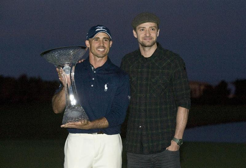 LAS VEGAS, NV - OCTOBER 24: Golfer Jonathan Byrd and Justin Timberlake pose with the trophy after Byrd hit a hole-in-one to win the tournament at the Justin Timberlake Shriners Hospitals for Children Open at TPC Sunderlin on October 24, 2010 in Las Vegas, Nevada. (Photo by Steve Dykes/Getty Images)