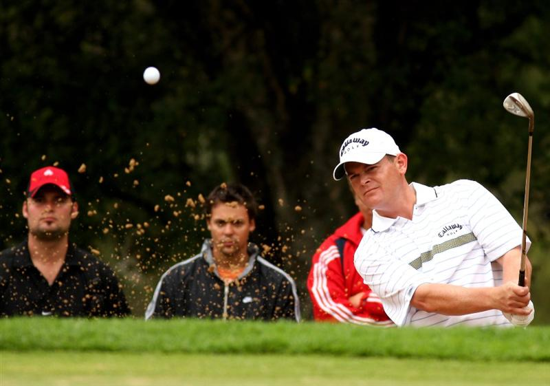 JOHANNESBURG, SOUTH AFRICA - JANUARY 11:  David Drysdale of Scotland plays from a greenside bunker on the 5th during the final round of the Joburg Open at Royal Johannesburg and Kensington Golf Club on January 11, 2009 in Johannesburg, South Africa.  (Photo by Richard Heathcote/Getty Images)