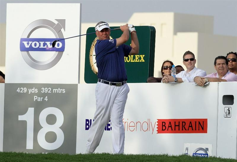 BAHRAIN, BAHRAIN - JANUARY 29: Darren Clarke of Northern Ireland drives at the 18th hole during the third round of the 2011 Volvo Champions held at the Royal Golf Club on January 29, 2011 in Bahrain, Bahrain.  (Photo by David Cannon/Getty Images)