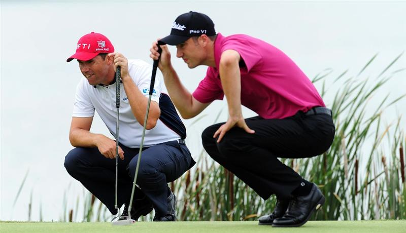 CHASKA, MN - AUGUST 15:  Ross Fisher of England and Padraig Harrington of Ireland look over the tenth green during the third round of the 91st PGA Championship at Hazeltine National Golf Club on August 15, 2009 in Chaska, Minnesota.  (Photo by Stuart Franklin/Getty Images)