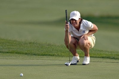 Julie Inkster studies a putt on  the 18th green  during the second round  at Newport Country Club, site of the 2006 U. S. Women's Open in Newport, Rhode Island, July 1.Photo by Al Messerschmidt/WireImage.com