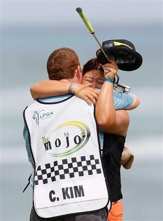 MONTEGO BAY, JAMAICA - APRIL 16:  Christina Kim reacts with her caddie after losing her quarterfinal match of The Mojo 6 Jamaica LPGA Invitational at Cinnamon Hill Golf Course on April 16, 2010 in Montego Bay, Jamaica.  (Photo by Kevin C. Cox/Getty Images)