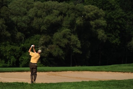 OAKVILLE, ON - JULY 25:  Jim Furyk makes an approach shot on the 13th hole as he resumes his first round that was delayed by rainstorms yesterday at the RBC Canadian Open at the Glen Abbey Golf Club on July 25, 2008 in Oakville, Ontario.   (Photo by Robert Laberge/Getty Images)