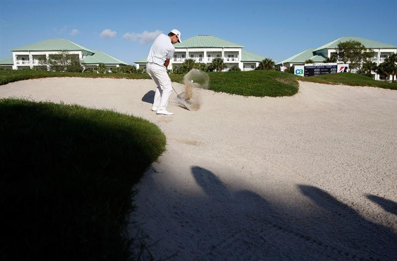 DORAL, FL - MARCH 15:  Nick Watney blasts from a bunker on the 12th hole during the final round of the World Golf Championships-CA Championship on March 15, 2009 at the Doral Golf Resort and Spa in Doral, Florida.  (Photo by Jamie Squire/Getty Images)