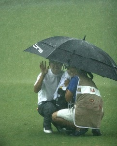 Kevin Na in waves from his umbrella on the fourth fairway during a sudden downpour during the third round of the 2007 Crowne Plaza Invitational at Colonial at the Colonial Country Club in Fort Worth, Texas, on May 26, 2007. PGA TOUR - 2007 Crowne Plaza Invitational at Colonial - Third RoundPhoto by Steve Grayson/WireImage.com
