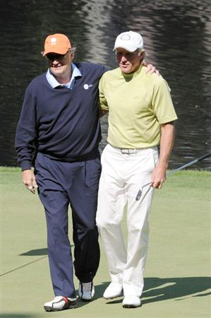 AUGUSTA, GA - APRIL 08:  Raymond Floyd and Greg Norman of Australia walk off a green during the Par 3 Contest prior to the 2009 Masters Tournament at Augusta National Golf Club on April 8, 2009 in Augusta, Georgia.  (Photo by Harry How/Getty Images)