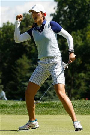 SUGAR GROVE, IL - AUGUST 22:  Michelle Wie of the U.S. Team reacts putt for birdie on the 10th green during the Saturday morning Fourball matches at the 2009 Solheim Cup at Rich Harvest Farms on August 22, 2009 in Sugar Grove, Illinois.  (Photo by Chris Graythen/Getty Images)