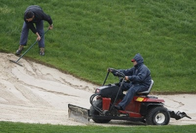 General view of green keepers as the repair a bunker after the rain washed out a number of bunkers on the course of the 2007 Open de Espana at Centro National de Golf in Madrid, Spain on April 26, 2007.