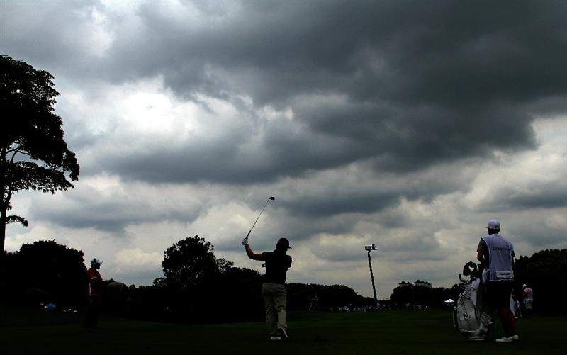 KUALA LUMPUR, MALAYSIA - OCTOBER 30: Ryan Moore of USA plays his 2nd shot on the 13th hole amiss heavy thunderstorm ahead during day three of the CIMB Asia Pacific Classic at The MINES Resort & Golf Club on October 30, 2010 in Kuala Lumpur, Malaysia. (Photo by Stanley Chou/Getty Images)