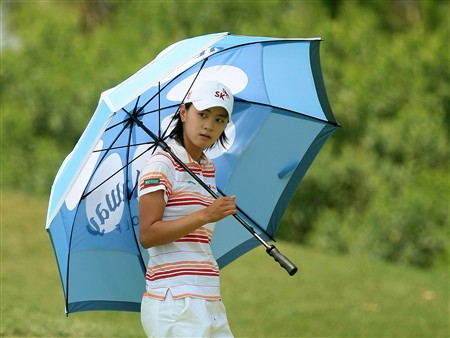 MT. PLEASANT, SC - JUNE 1:  Na Yeon Choi of South Korea waits under an umbrella during the final round of the Ginn Tribute at RiverTowne Country Club June 1, 2008 in Mt. Pleasant, South Carolina.  (Photo by Scott Halleran/Getty Images)