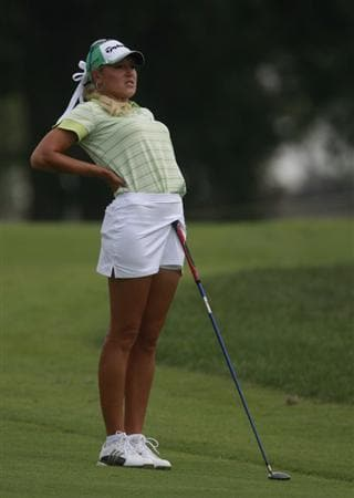 ROGERS, AR - SEPTEMBER 11:  Natalie Gulbis stretches while she waits to hit from the 18th fairway during first round play in the P&G Beauty NW Arkansas Championship at the Pinnacle Country Club on September 11, 2009 in Rogers, Arkansas.  (Photo by Dave Martin/Getty Images)