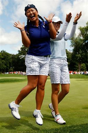 SUGAR GROVE, IL - AUGUST 22:  Christina Kim left, and Michelle Wie of the U.S. Team celebrate after defeating Helen Alfredsson and Tania Elosegui of the European Team during the Saturday morning Fourball matches at the 2009 Solheim Cup at Rich Harvest Farms on August 22, 2009 in Sugar Grove, Illinois.  (Photo by Chris Graythen/Getty Images)