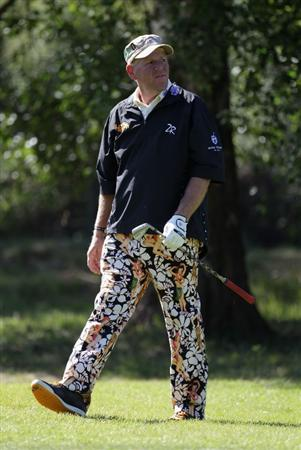 VIRGINIA WATER, ENGLAND - MAY 25:  John Daly of USA in action during the Pro-Am round prior to the BMW PGA Championship at Wentworth Club on May 25, 2011 in Virginia Water, England.  (Photo by Ross Kinnaird/Getty Images)