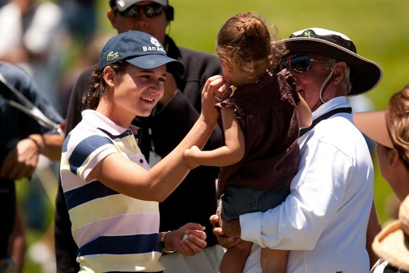 MORELIA, MEXICO - MAY 1: Lorena Ochoa of Mexico with her father, Javier, and niece during the third round of the Tres Marias Championship at the Tres Marias Country Club on May 1, 2010 in Morelia, Mexico. (Photo by Darren Carroll/Getty Images)