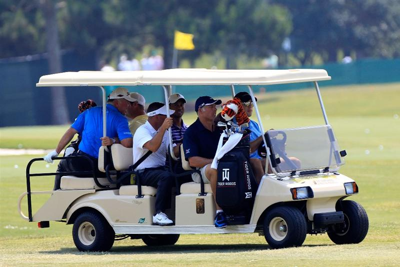 PONTE VEDRA BEACH, FL - MAY 10:  Tiger Woods, golf instructor Sean Foley, caddie Steve Williams and Mark O'Meara ride on a golf cart during a practice round prior to the start of THE PLAYERS Championship held at THE PLAYERS Stadium course at TPC Sawgrass on May 10, 2011 in Ponte Vedra Beach, Florida.  (Photo by Sam Greenwood/Getty Images)