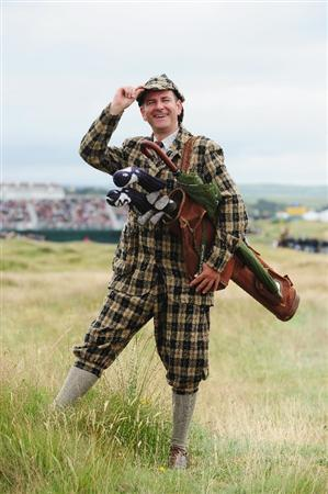 TURNBERRY, SCOTLAND - JULY 18:  A golf fan dressed in vintage attire enjoys the atmosphere during round three of the 138th Open Championship on the Ailsa Course, Turnberry Golf Club on July 18, 2009 in Turnberry, Scotland.  (Photo by Stuart Franklin/Getty Images)