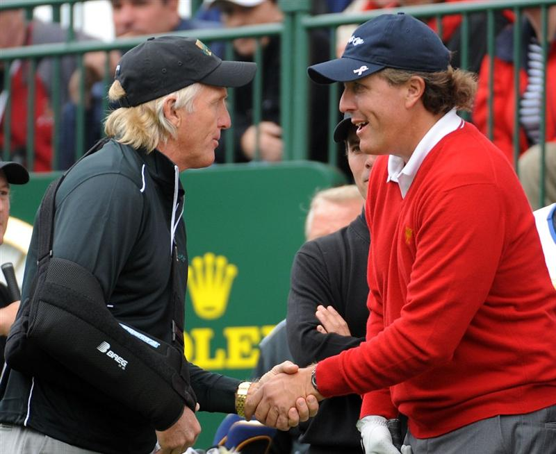 SAN FRANCISCO - OCTOBER 08:  Captain Greg Norman of the International Team shakes hands with Phil Mickeson of the USA Team on the first tee during the Day One Foursome Matches of The Presidents Cup at Harding Park Golf Course on October 8, 2009 in San Francisco, California.  (Photo by Harry How/Getty Images)