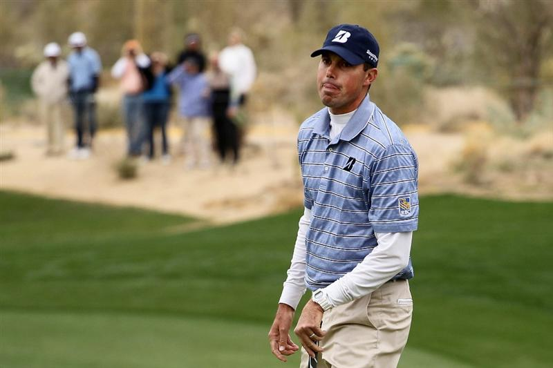 MARANA, AZ - FEBRUARY 26:  Matt Kuchar reacts on the 13th green after losing to Luke Donald of England (not pictured) during the semifinal round of the Accenture Match Play Championship at the Ritz-Carlton Golf Club on February 26, 2011 in Marana, Arizona.  (Photo by Andy Lyons/Getty Images)