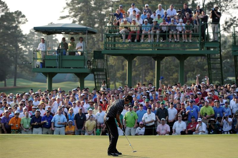 AUGUSTA, GA - APRIL 10:  Charl Schwartzel of South Africa putts for birdie en route to his two-stroke victory on the 18th green during the final round of the 2011 Masters Tournament at Augusta National Golf Club on April 10, 2011 in Augusta, Georgia.  (Photo by Harry How/Getty Images)