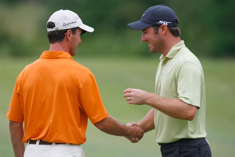 NORTON, MA - AUGUST 30:  Mike Weir, left, shakes hands with Trevor Immelman during the second round of the Deutsche Bank Championship at the TPC Boston on August 30, 2008 in Norton, Massachusetts. (Photo by Jim Rogash/Getty Images)
