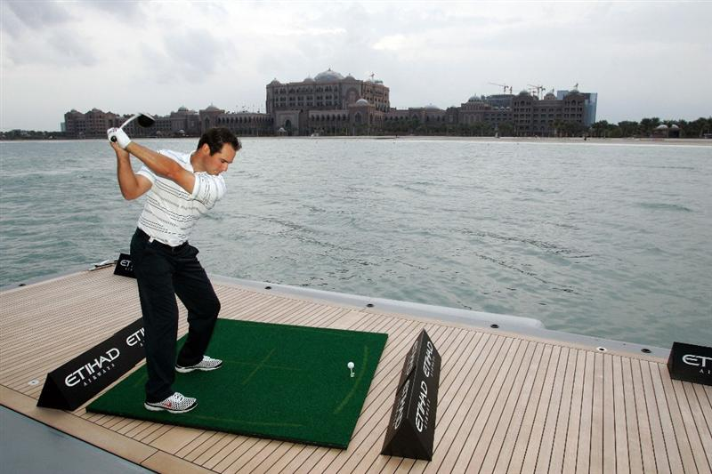 ABU DHABI, UNITED ARAB EMIRATES - JANUARY 14:  Trevor Immelman of South Africa, the 2008 Masters Champion, takes on the Etihad Airways 'Shot from the Yacht' challenge on the World's 66th largest yacht towards the Emirates Palace Hotel on January 14 2009, in Abu Dhabi, United Arab Emirates.  (Photo by Getty Images for Etihad)