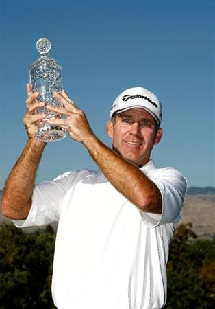 BOISE, ID - SEPTEMBER 20:  Fran Quinn hoists the trophy after winning the final round of the Albertson's Boise Open at Hillcrest Country Club on September 20, 2009 in Boise, Idaho.  (Photo by Jonathan Ferrey/Getty Images)