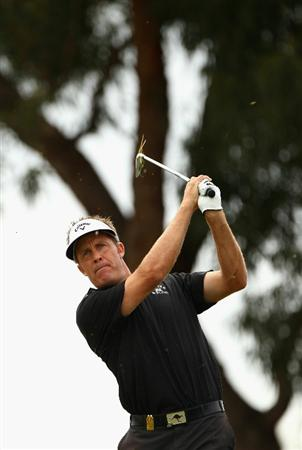MELBOURNE, AUSTRALIA - NOVEMBER 14:  Stuart Appleby of Australia hits an iron shot during round four of the Australian Masters at The Victoria Golf Club on November 14, 2010 in Melbourne, Australia.  (Photo by Ryan Pierse/Getty Images)