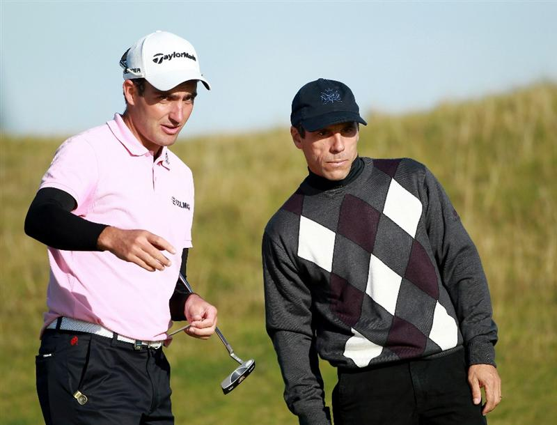 KINGSBARNS, SCOTLAND - OCTOBER 07:  Edoardo Molinari of Italy with his playing partner Gianfranco Zola on the sixth green during the first round of The Alfred Dunhill Links Championship at Kingsbarns Golf Links on October 7, 2010 in Kingsbarns, Scotland.  (Photo by Andrew Redington/Getty Images)