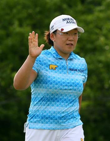 GLADSTONE, NJ - MAY 22: Jiyai Shin of South Korea waves to the crowd after making her birdie putt on the sixteenth hole during the third round of the Sybase Match Play Championship at Hamilton Farm Golf Club on May 22, 2010 in Gladstone, New Jersey. (Photo by Hunter Martin/Getty Images)