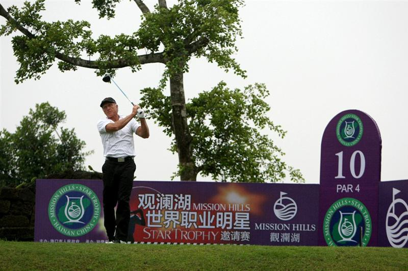HAIKOU, CHINA - OCTOBER 27:  Golf legend Greg Norman play a shot ahead of the inaugural Mission Hills Star Trophy on October 27, 2010 in Haikou, China. The Mission Hills Star Trophy is Asia's leading leisure liflestyle event and features Hollywood celebrities and international golf stars.  (Photo by Athit Perawongmetha/Getty Images)