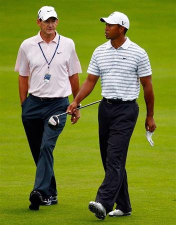 CHASKA, MN - AUGUST 10:  Tiger Woods (R) chats with his swing coach Hank Haney during a practice round prior to the start of the 91st PGA Championship at the Hazeltine Golf Club on August 10, 2009 in Chaska, Minnesota.  (Photo by Scott Halleran/Getty Images)
